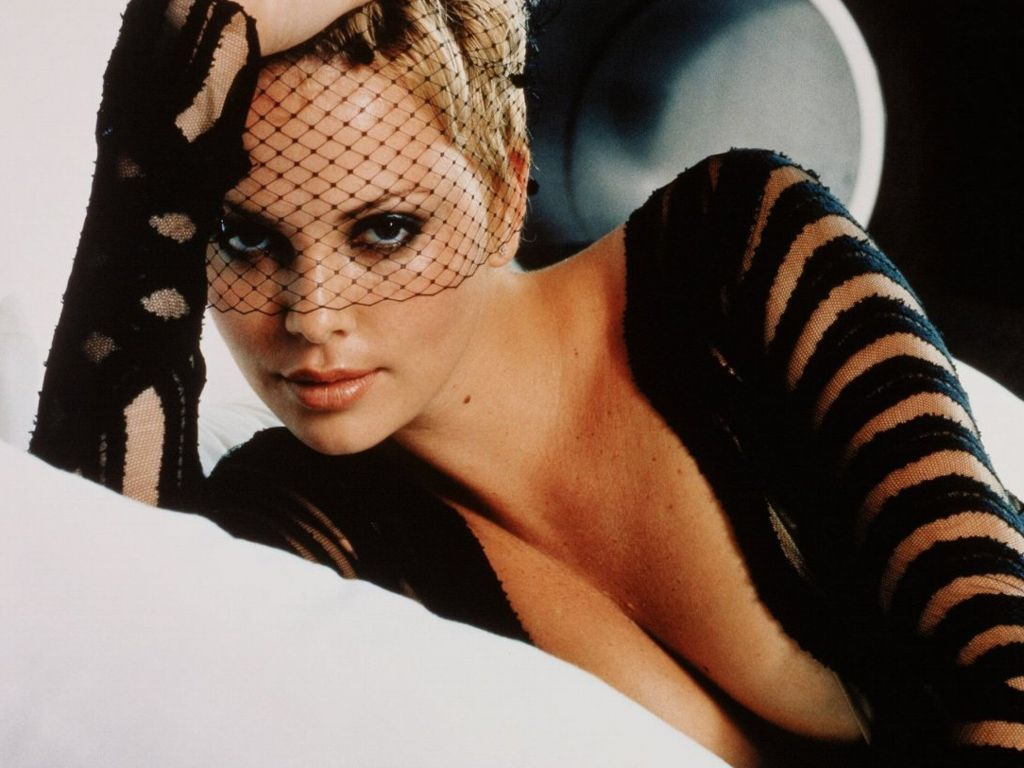 charlize theron cleavage lace over face